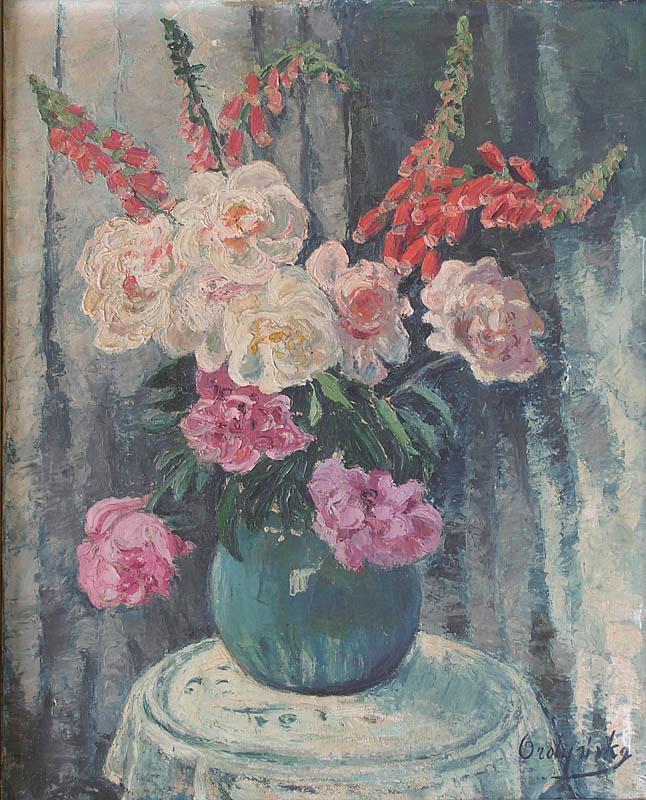 Bouquet des pivoines dans un vase bleu