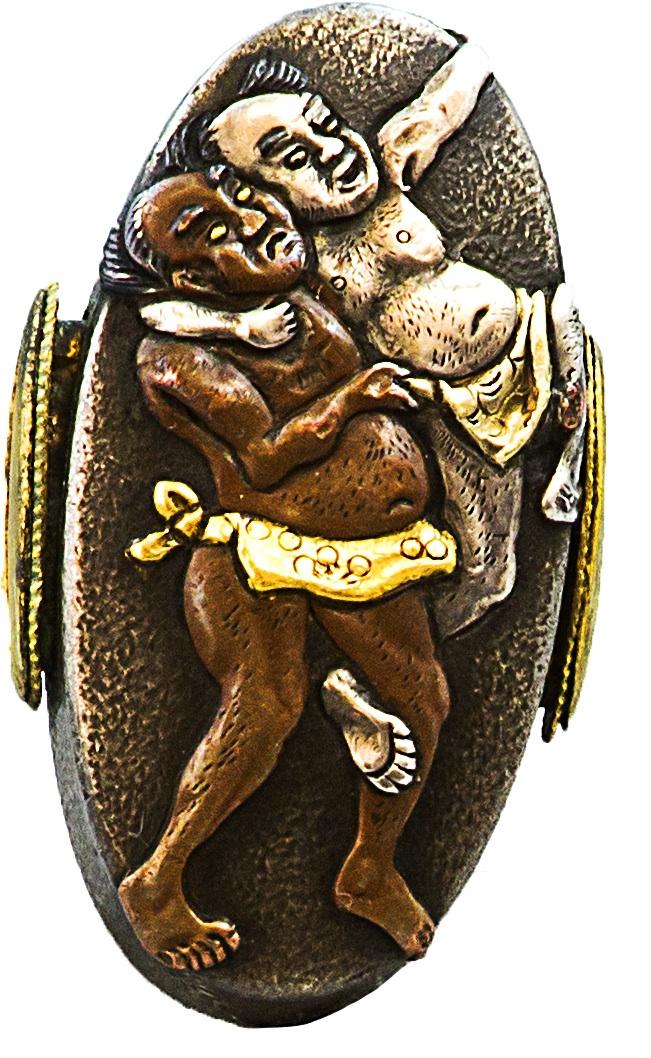 Kashira z przedstawieniem wojowników sumo
