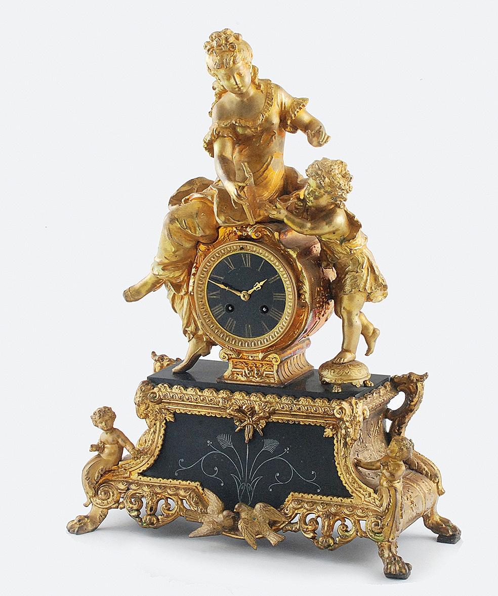 Zegar kominkowy z alegorią nauczania