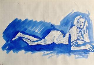 Akt kobiety leżącej na brzuchu