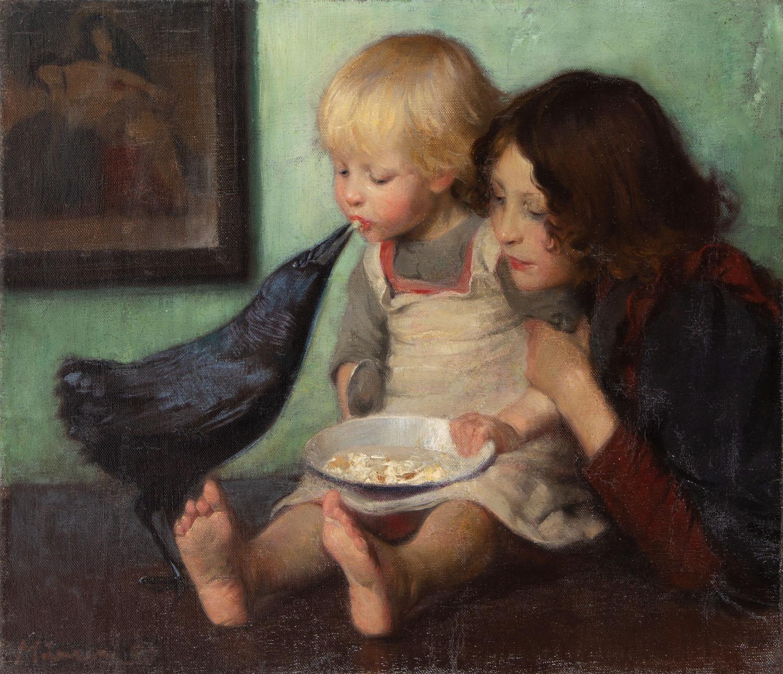 Dzieci bawiące się z krukiem