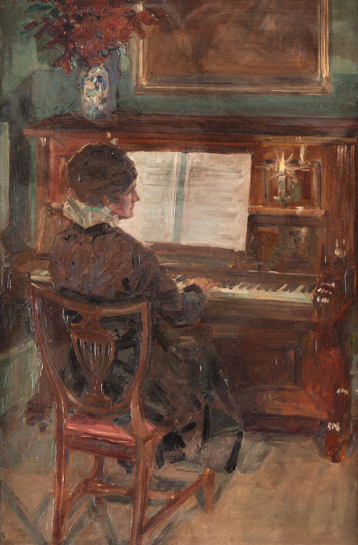 Kobieta grająca na pianinie
