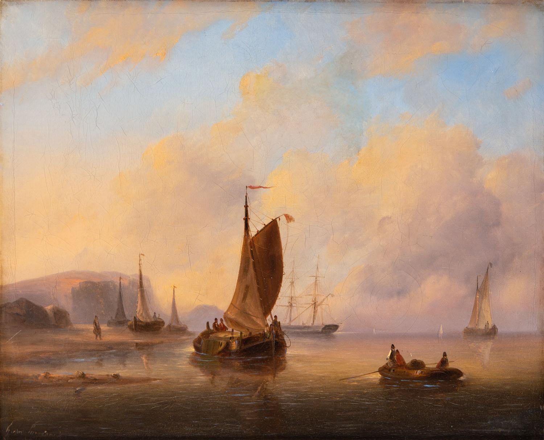 Łodzie na morzu o zachodzie słońca