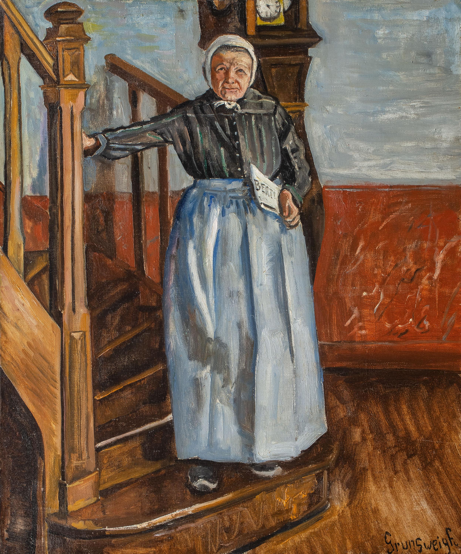 Starsza kobieta z gazetą