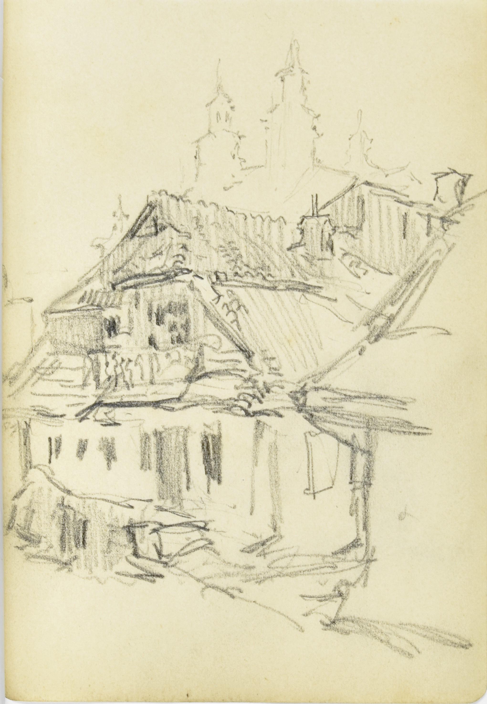 Zabudowania miejskie z wieżami kościelnymi w tle