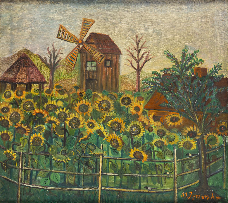 Pole słoneczników przy wiatraku