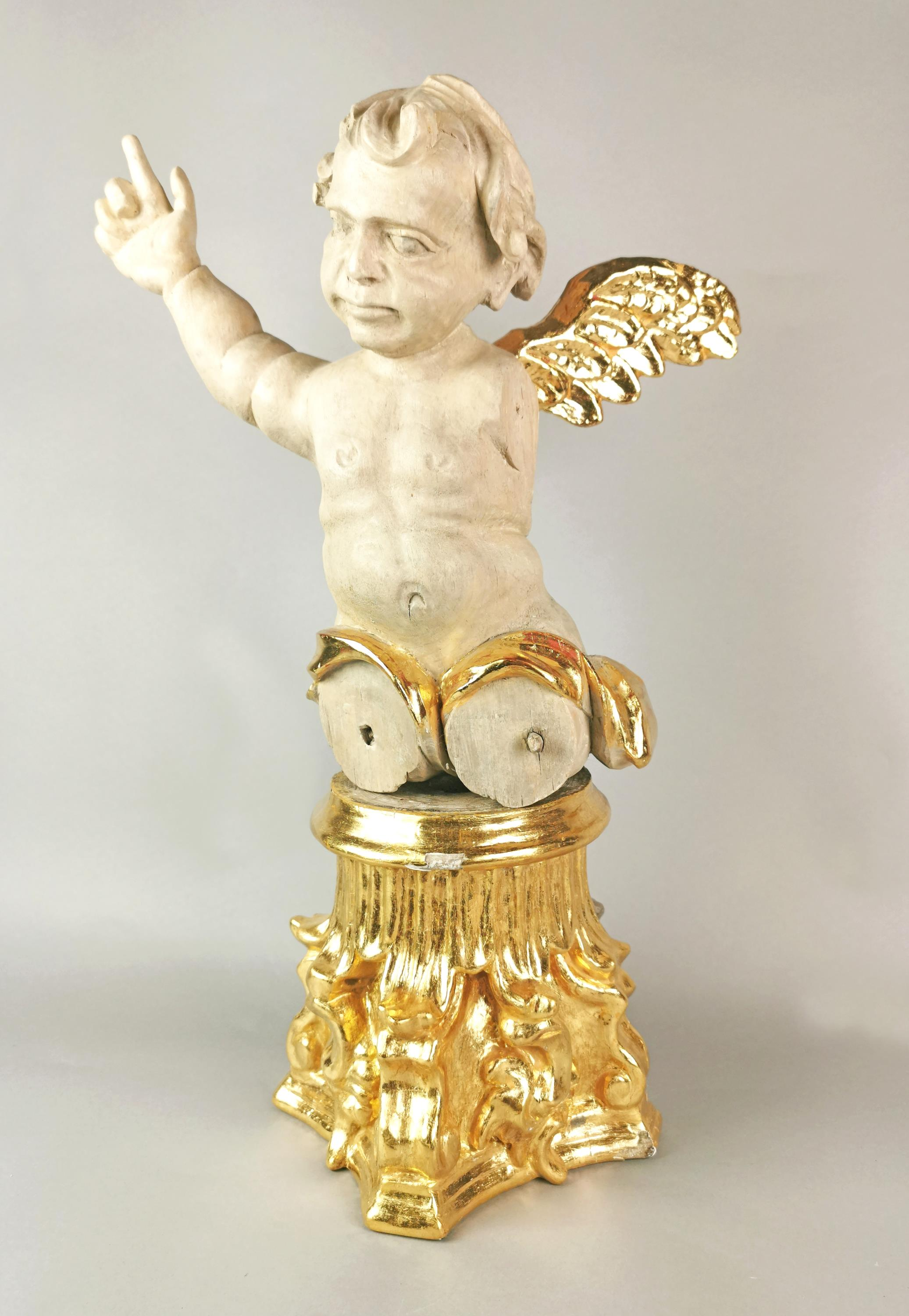 Uskrzydlone putto