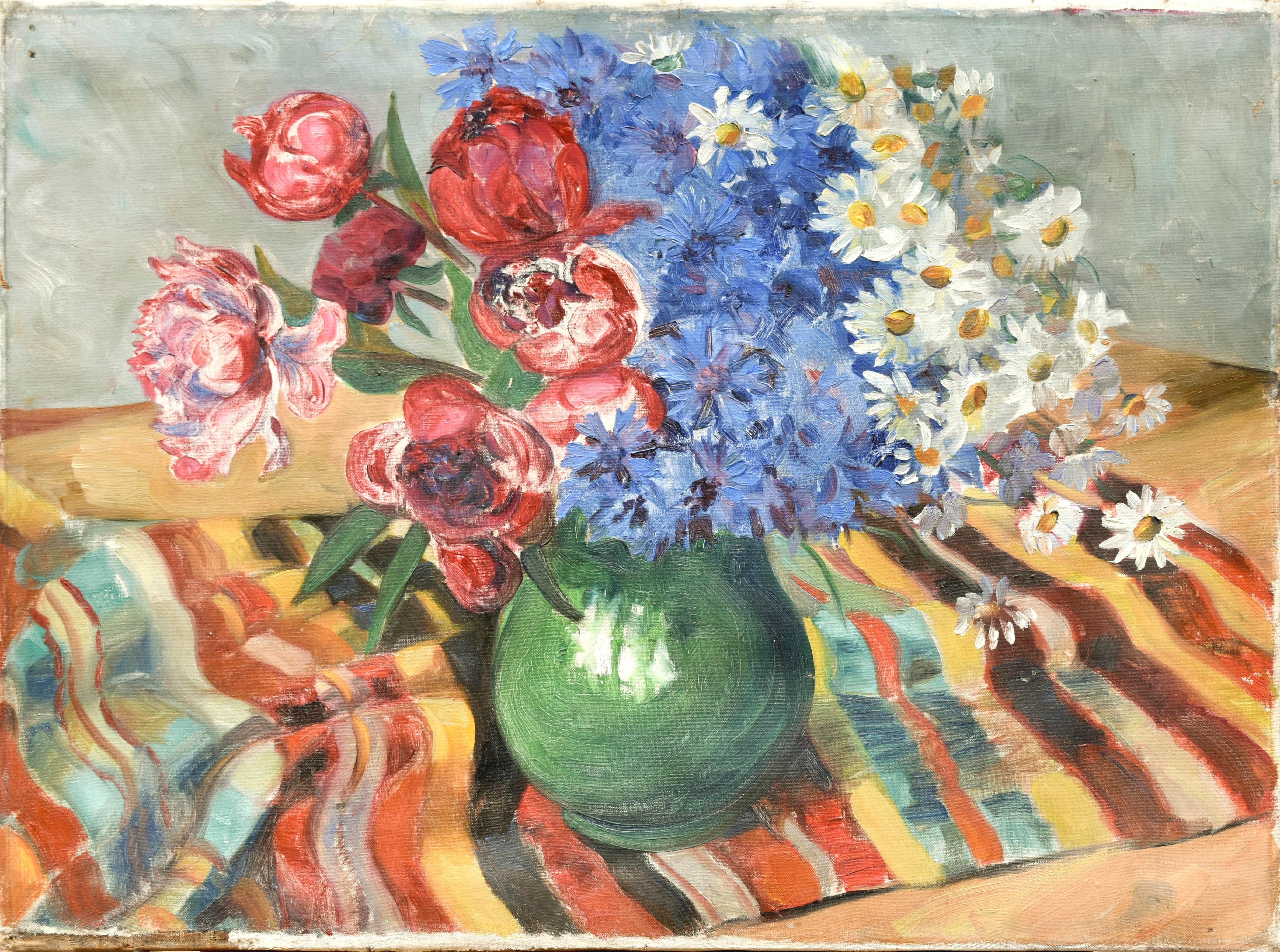 Bukiet kwiatów w zielonym dzbanku