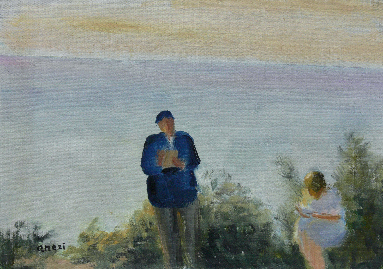 Czytający na tle morza