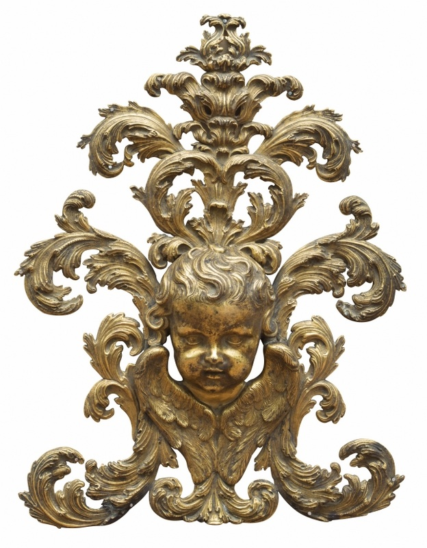 Aplika z puttem (An Italian gilt bronze putto applied ornament)