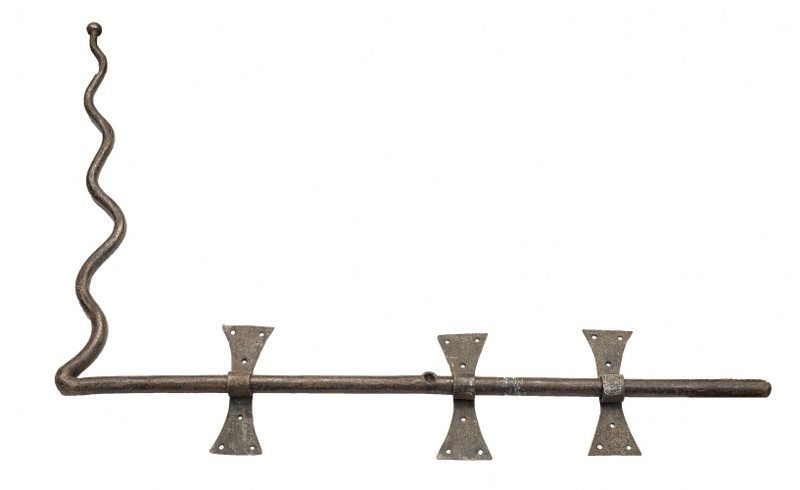 Zasuwa żelazna (An iron door latch)
