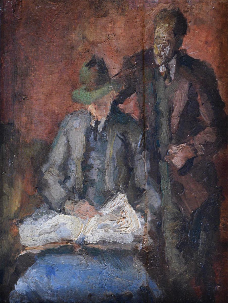 Dwóch mężczyzn czytających gazetę